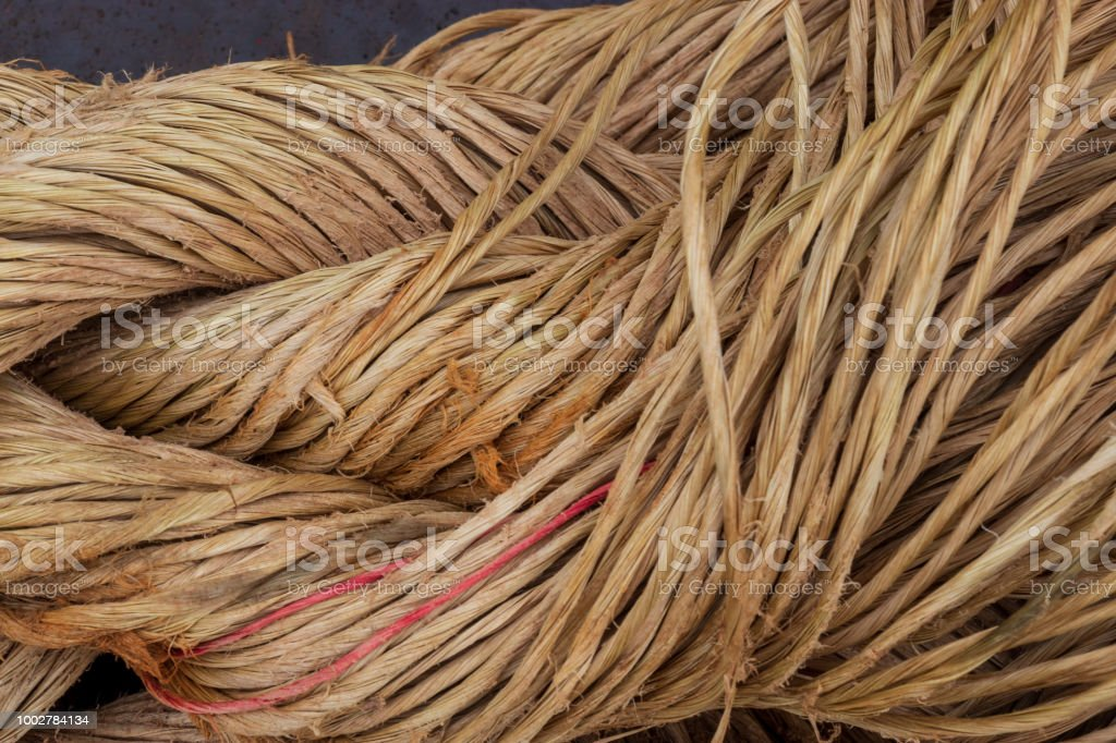A close up of braided natural fiber brown rope starting to unravel. stock photo