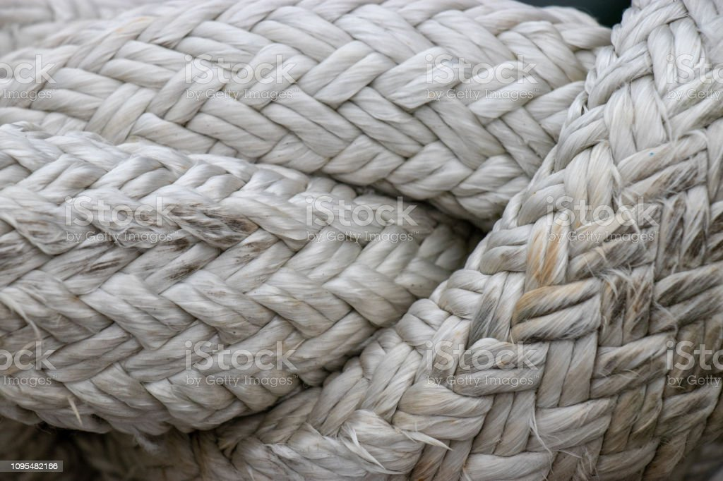 A close up of braided white rope. stock photo