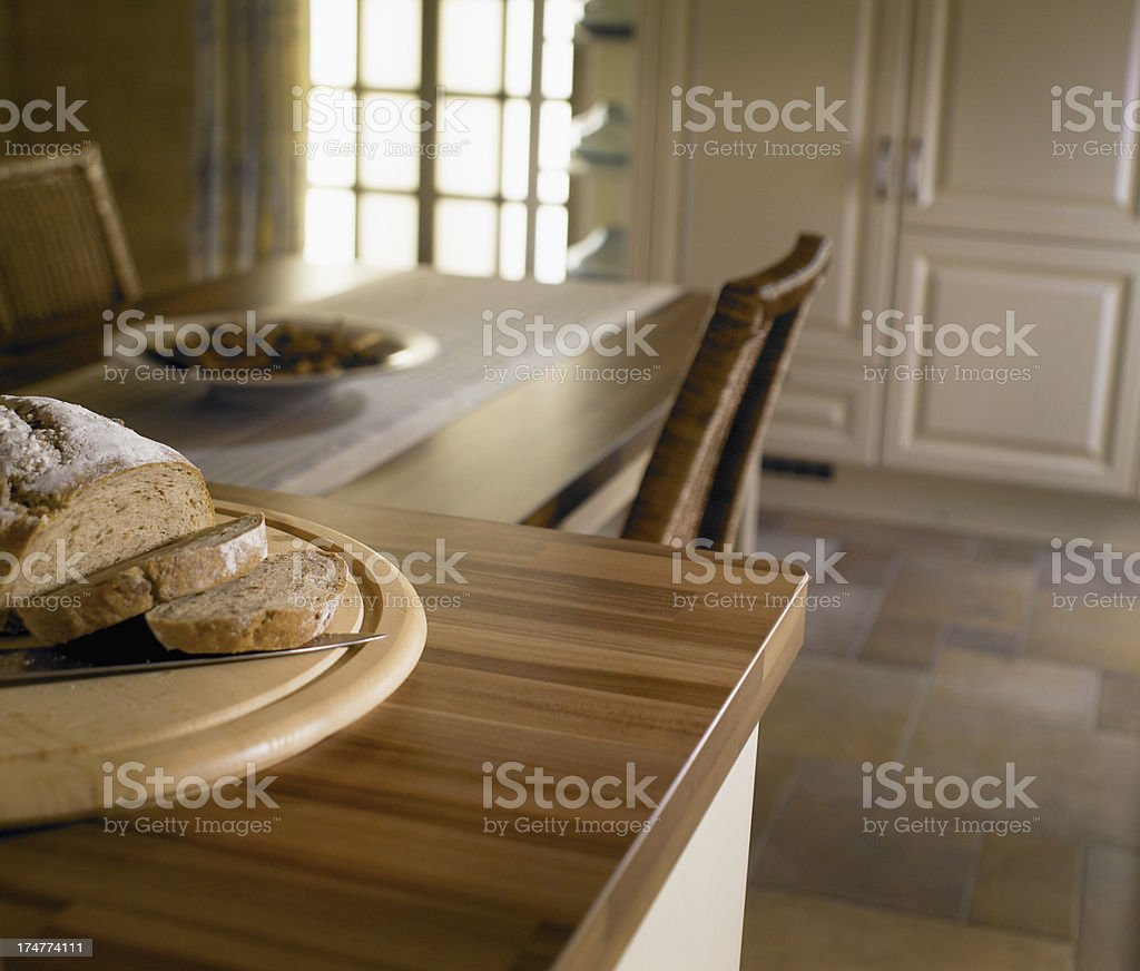 Close up of bread on breakfast bar within kitchen royalty-free stock photo