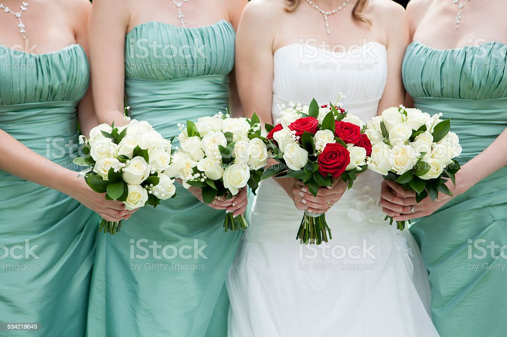 Close Up Of Bride And Bridesmaids Holding Flowers stock photo