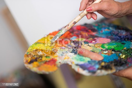istock Close up of bright gouache of different colors on color palette 1153161262