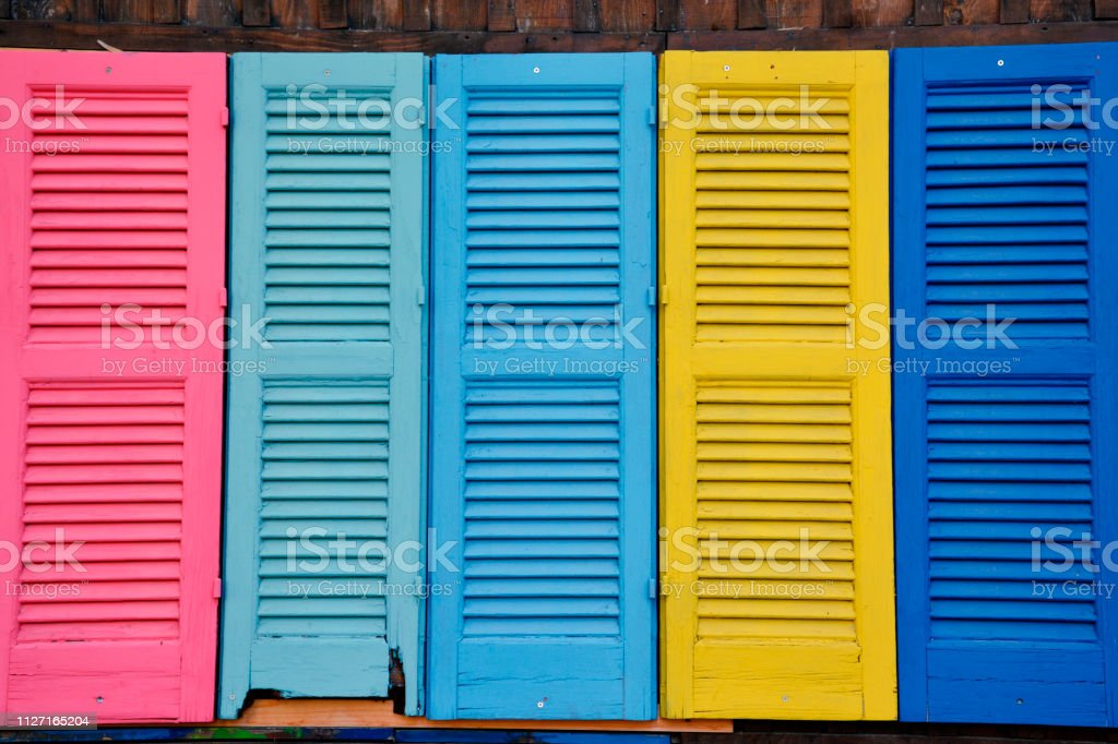 Close up of Brightly Coloured Wooden Vintage Windows stock photo