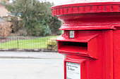 Close up of British red post box