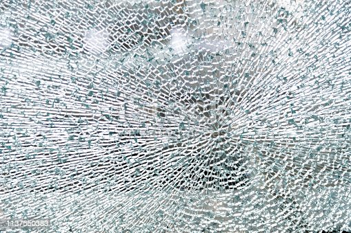 Close up of broken glass texture background.