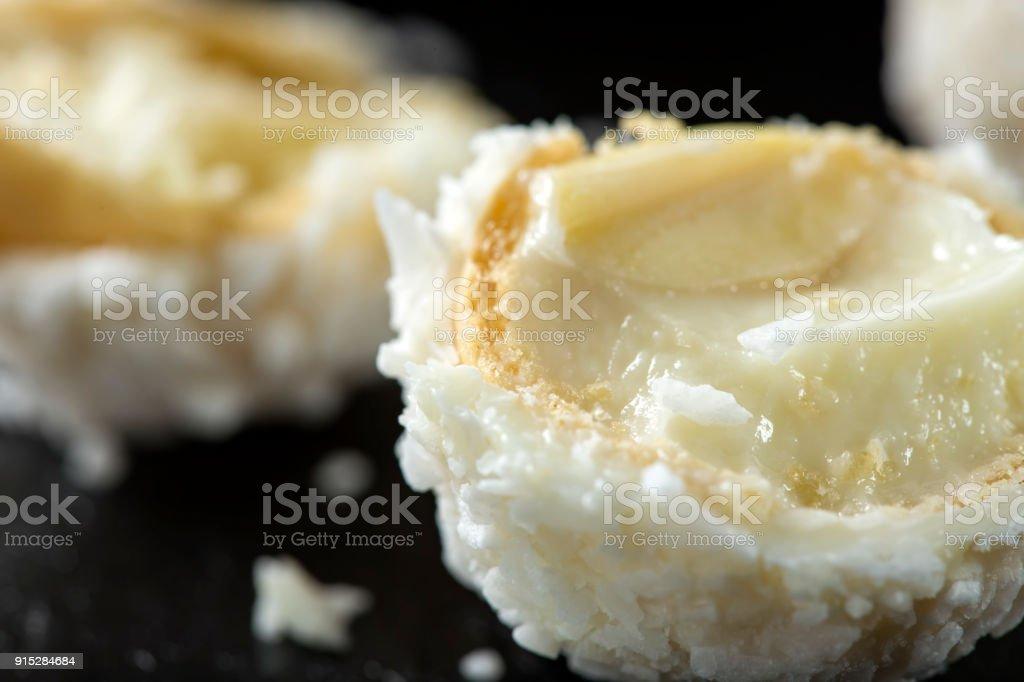 Close up of broken Raffaello white candy with coconut flakes stock photo
