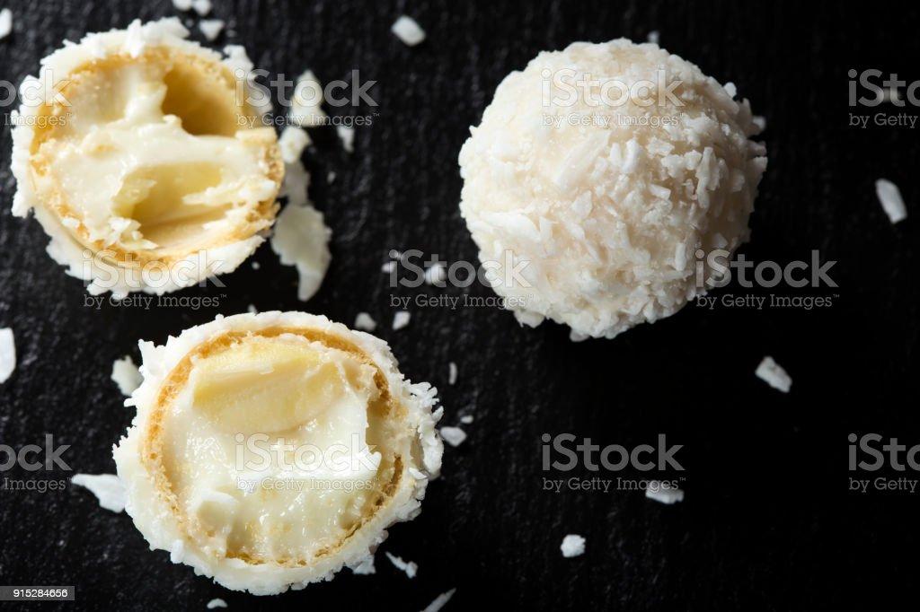 Close up of broken Raffaello white candy with white cream stock photo