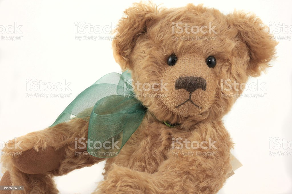 Close up of Brown Handmade Teddy Bear with Green Ribbon royalty-free stock photo