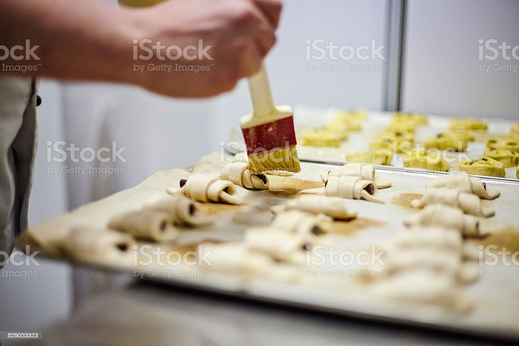 Close up of brush and croissants stock photo