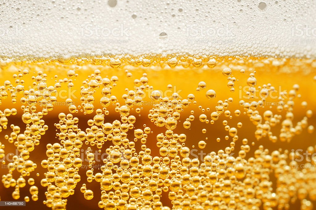 A close up of bubbles in the beer stock photo