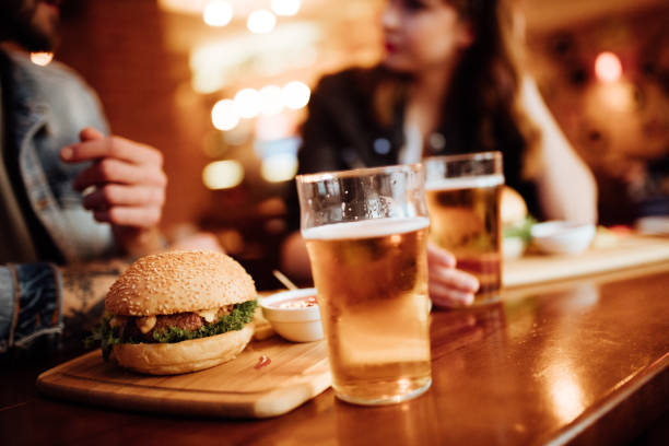 Close up of burger and beer on a table stock photo