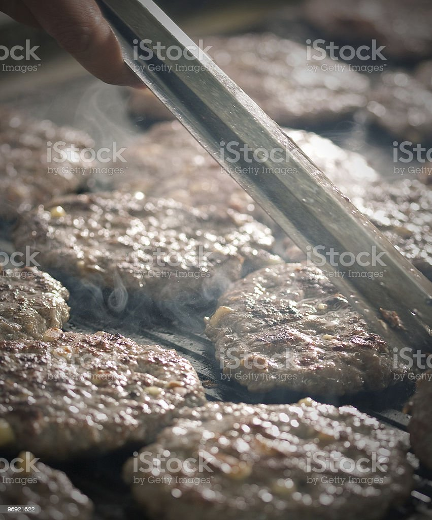 Close up of burgers on a barbeque royalty-free stock photo