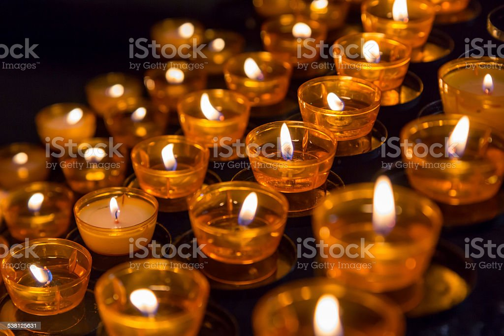Close up of burning tea light candles in a church stock photo
