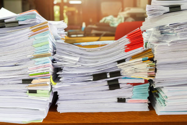 Close up of business documents stack on desk , report papers stack Close up of business documents stack on desk , report papers stack stack stock pictures, royalty-free photos & images