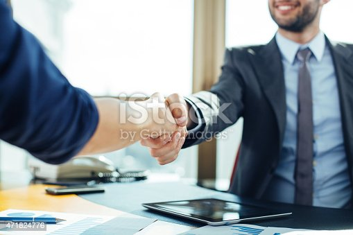 635949862 istock photo Close up of business handshake in the office 471824776