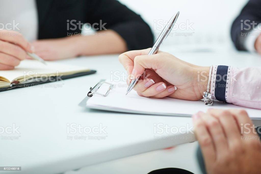 Close up of business people hands during teamwork. Business job...