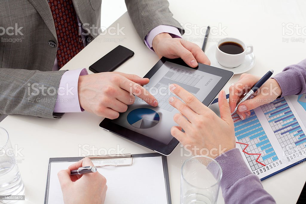 Close up of  business people' hands with a Liquid-Crystal Display stock photo