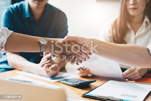istock Close up of Business people shaking hands, finishing up meeting, business etiquette, congratulation, merger and acquisition concept 1126026118