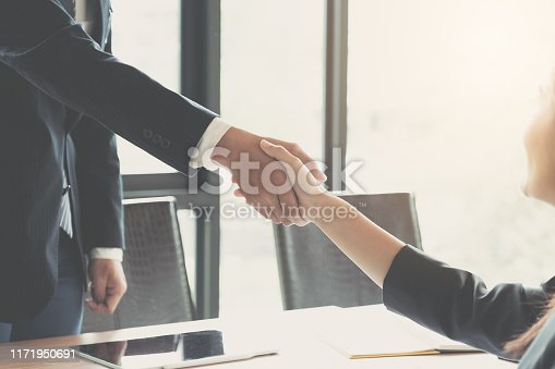 istock Close up of Business people shaking hands, finishing up meeting, business etiquette, congratulation, merger and acquisition concept 1171950691