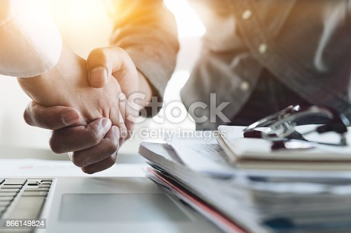 istock Close up of Business people shaking hands, finishing up meeting, business etiquette, congratulation, merger and acquisition concept 866149824