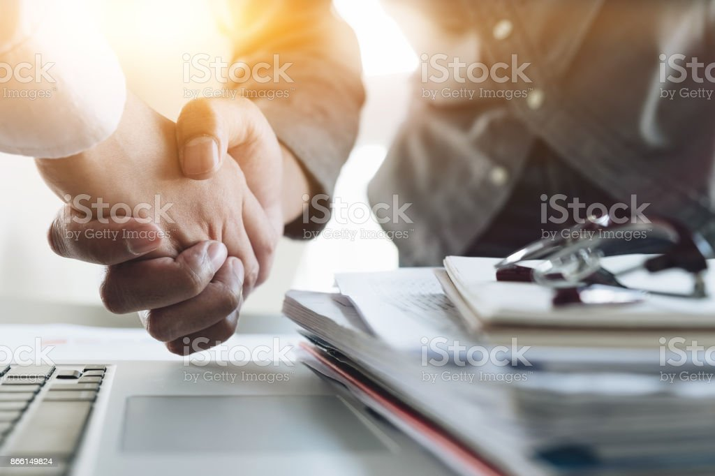 Close up of Business people shaking hands, finishing up meeting, business etiquette, congratulation, merger and acquisition concept stock photo