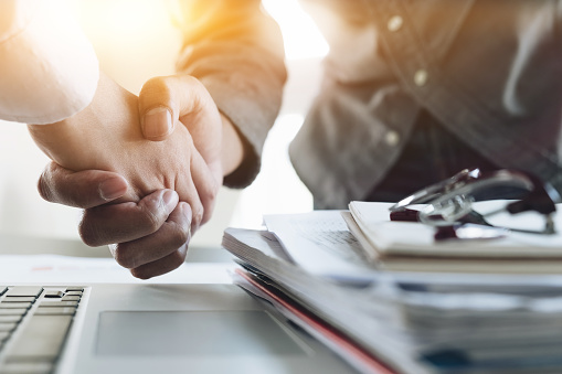 Close Up Of Business People Shaking Hands Finishing Up Meeting Business Etiquette Congratulation Merger And Acquisition Concept Stock Photo - Download Image Now