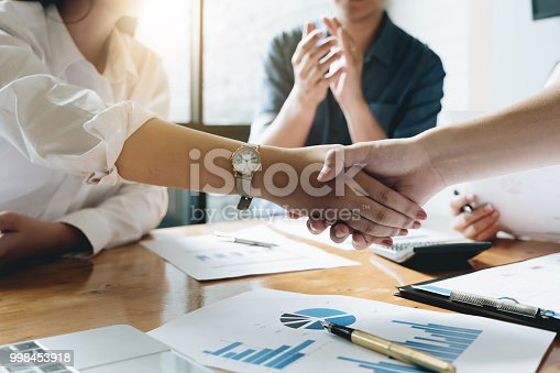 istock Close up of Business people shaking hands, finishing up meeting, business etiquette, congratulation, merger and acquisition concept 998453918