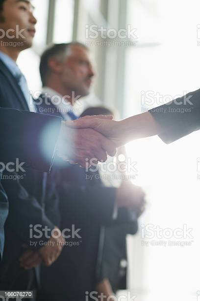 Close up of business people shaking hands in a row picture id166076270?b=1&k=6&m=166076270&s=612x612&h=yeruhtqcn10pimml2wvcpu4pjss lbk1oop9q5 yfg8=
