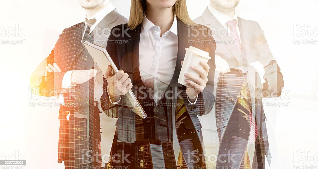 Close up of business trio and a morning cityscape royalty-free stock photo