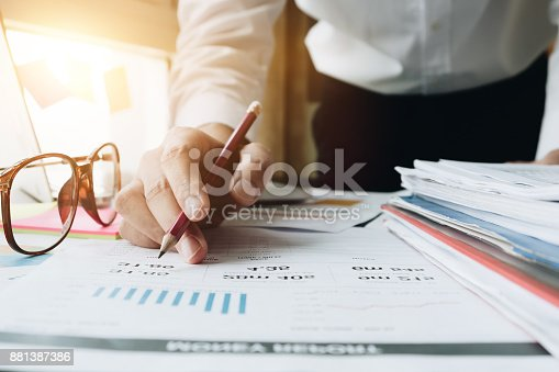 istock Close up of Business woman investment consultant analysis company annual financial report balance sheet statement working with documents graphs. Concept picture of economy, market, office,money and tax. 881387386
