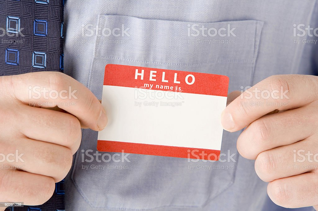 Close Up Of Businessman Attaching Name Tag stock photo