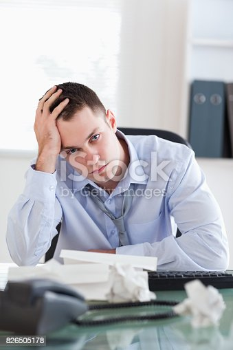 690496350istockphoto Close up of businessman being depressed by accounting 826505178