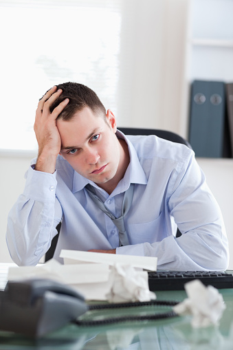 690496350 istock photo Close up of businessman being depressed by accounting 826505178