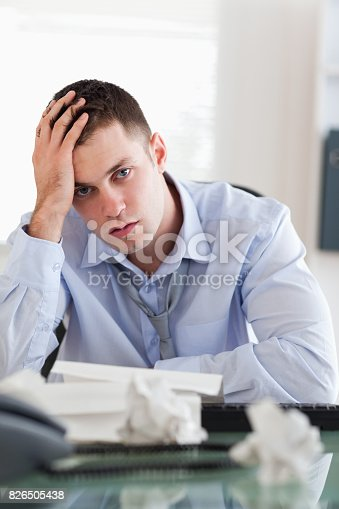 690496350istockphoto Close up of businessman being overextended with his accounting 826505438