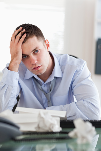 690496350 istock photo Close up of businessman being overextended with his accounting 826505438