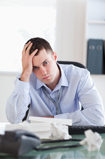690496350 istock photo Close up of businessman being unhappy about accounting 826505124
