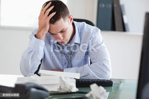 690496350istockphoto Close up of businessman frustrated with paperwork 826504958