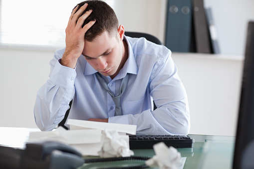 690496350 istock photo Close up of businessman frustrated with paperwork 826504958