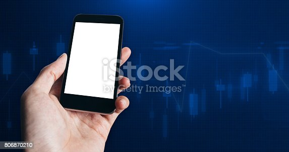 860389678 istock photo Close up of Businessman hand holding smart phone with Blank White Screen on Stock market financial analysis indicator background 806870210