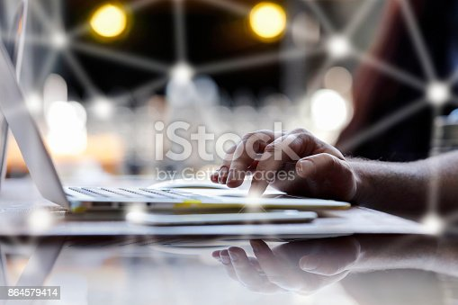 istock Close up of businessman or freelancer working on laptop computer 864579414