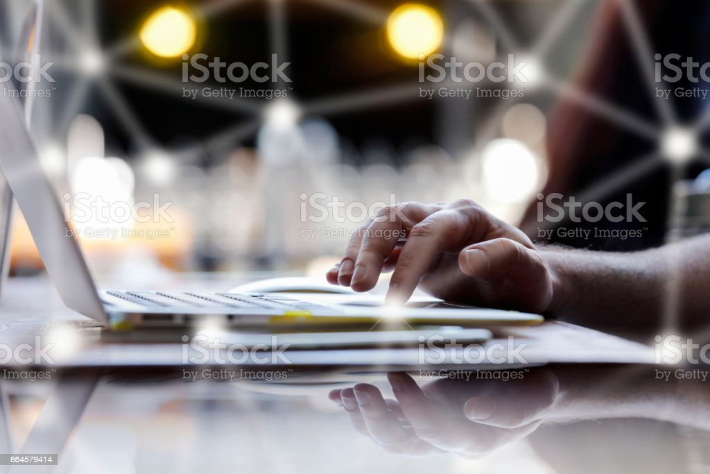 Close up of businessman or freelancer working on laptop computer stock photo