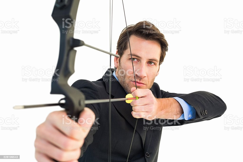 Close up of businessman shooting bow and arrow stock photo