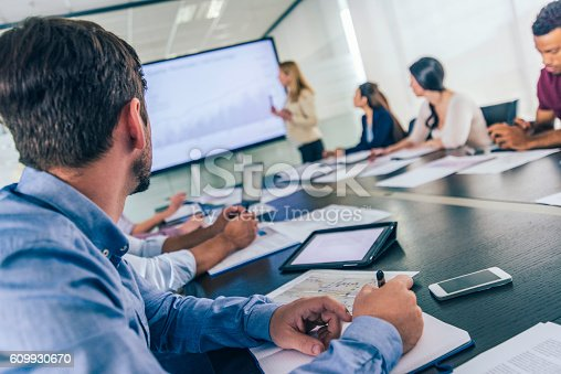 istock Close up of businessman taking notes on a seminar 609930670