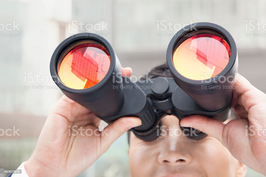 Close Up of Businessman Using Binoculars, Reflection stock photo