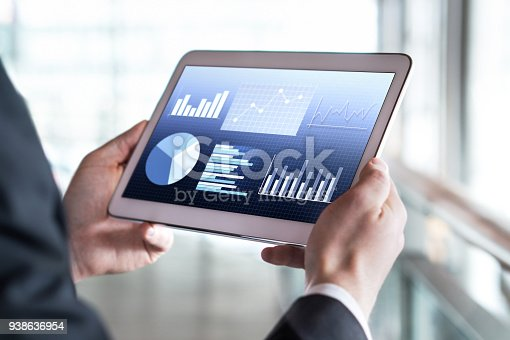 istock Close up of businessman using tablet in modern office building. 938636954