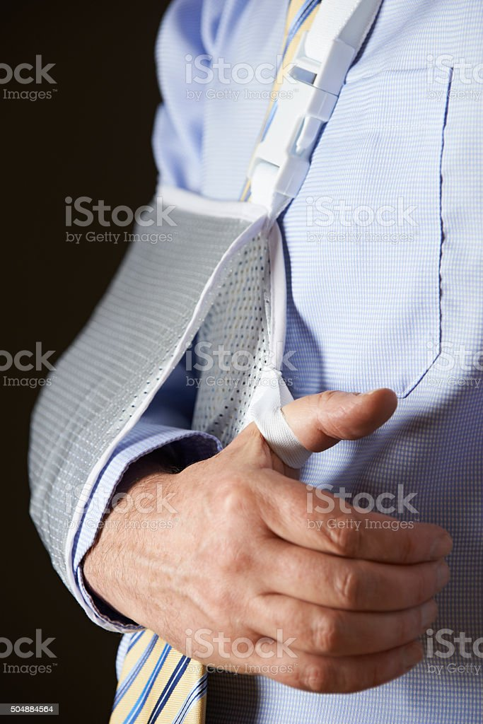 Close Up Of Businessman With Arm In Sling stock photo