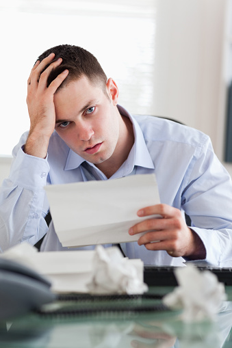 690496350 istock photo Close up of businessman worried about bills 826505630