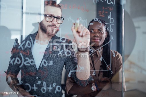 istock Close up of businessman writing down math formulas 926382714