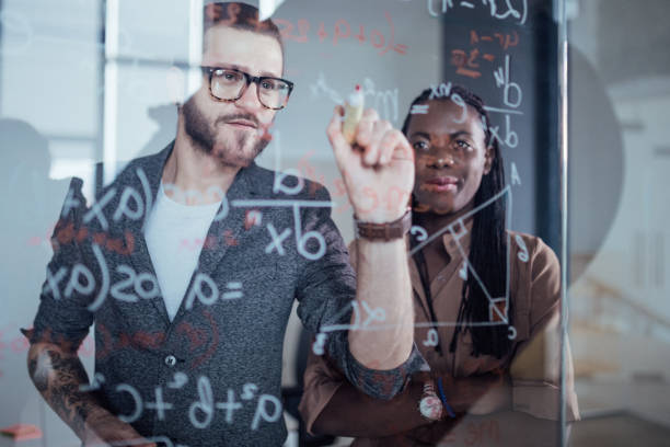 Close up of businessman writing down math formulas - foto stock