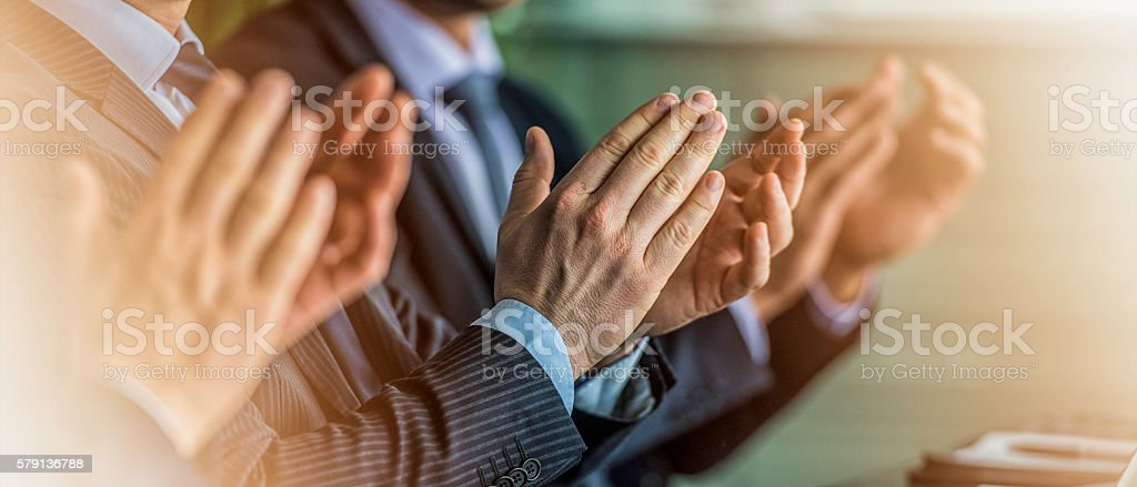 Close up of businessmen in suits clapping – Foto