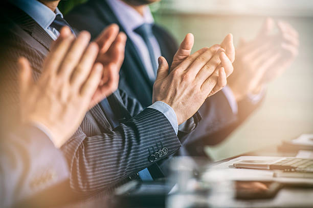 Close up of businessmen's hands clapping on a meeting ストックフォト